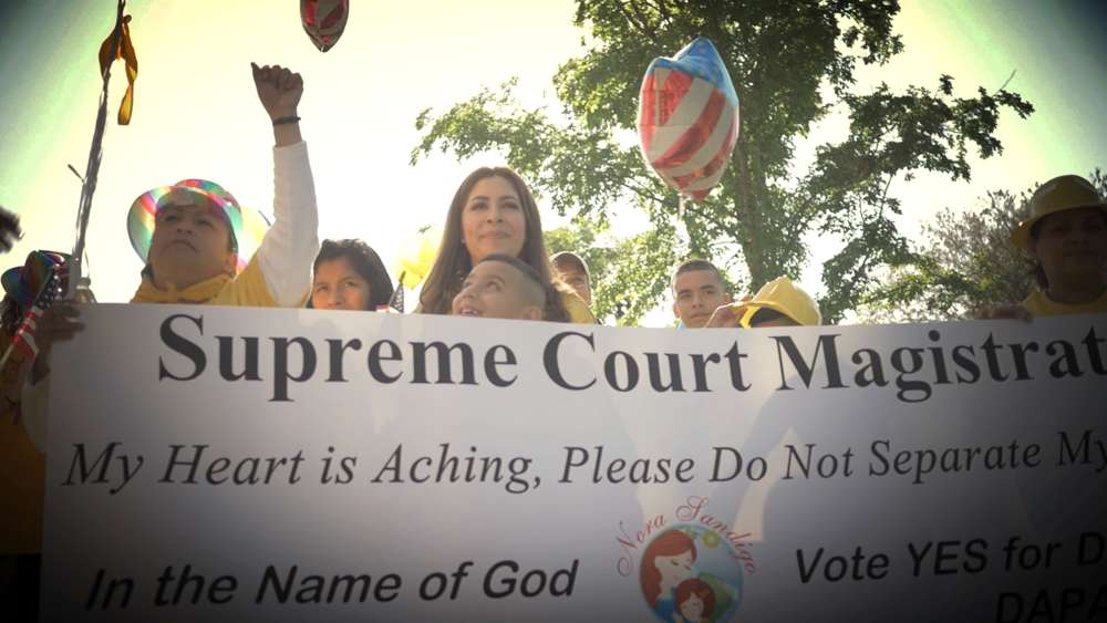 Nora Sandigo leads her supporters to the Supreme Court in Washington, D.C.
