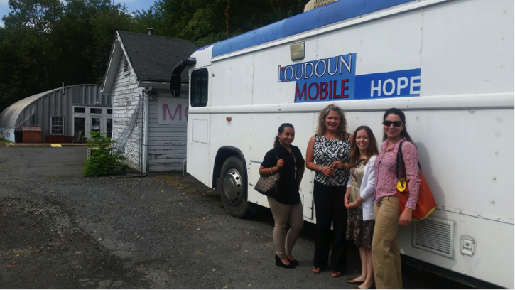 At Mobile Hope's facilities standing in front of the Mobile Hope bus: Anna-Maria, Donna Fortier, Jennifer, and Dr. Rethy