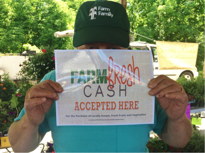 A shy, but awesome, Clinton County Farmer helps promote Farm Fresh Cash.