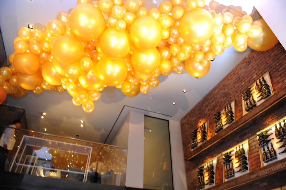 A display of golden balloons framing walls of the townhouse.