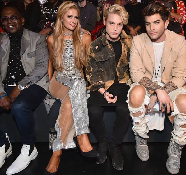 Pictured: Randy Jackson, Paris Hilton, Guest, and Adam Lambert sitting front row