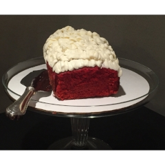 RED VELVET CAKE WITH CREAM CHEESE ICING $15.00+    A rich, moist cake, velvety red in color, topped with real cream cheese icing and white chocolate shavings. The ultimate flavor in red velvet!