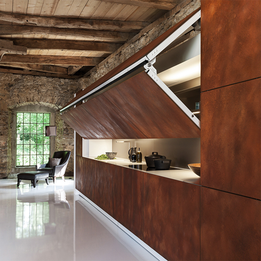 hidden kitchen design. We are seeing inventive ways of hiding work spaces and small appliances  using vertical folding doors such as in the kitchen above by Poliform Varenna The Hidden Kitchen FDK Design