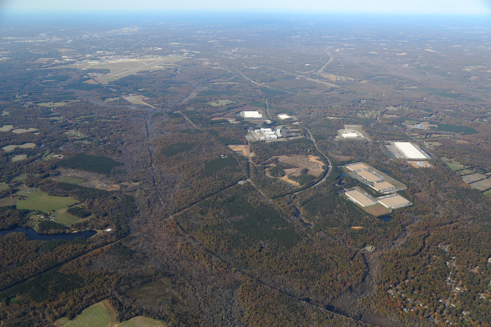 Whole Park from SE wide w Aiport and Highways.jpg