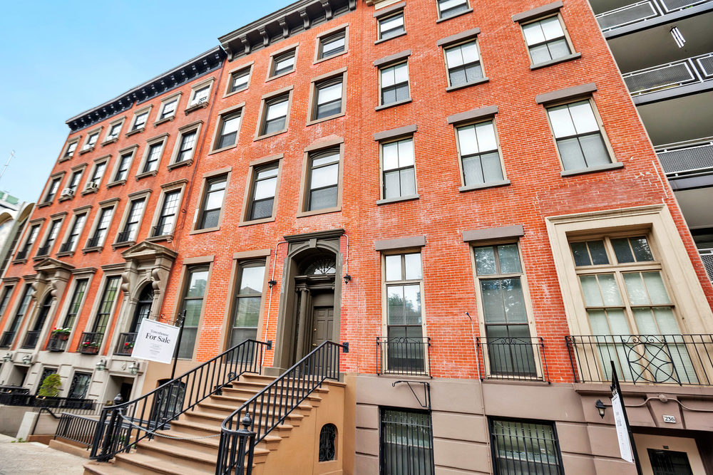 The Greek Revival-style townhomes, located at 236 and 238 East 15th St. in Gramercy, were acquired by the Missionary Sisters of the Immaculate Heart of Mary in the early 1940s. -COMPASS