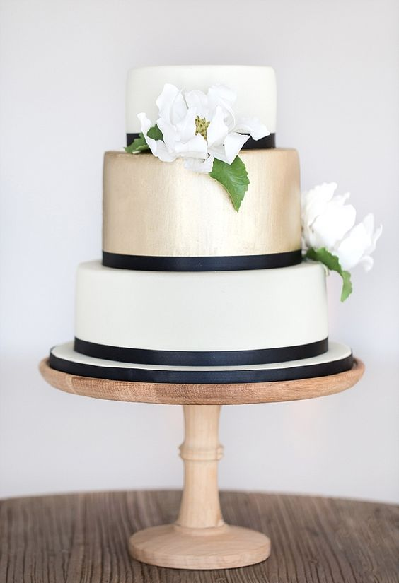 Three-Tier White and Gold Wedding Cake with Navy Ribbons