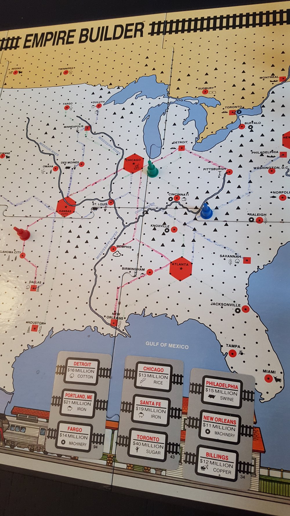 Empire Builder game in progress with three players and example demand cards.