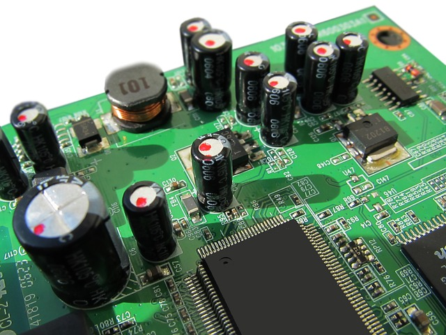 Printed circuit board. The large computer chips contain millions of silicon transistors.