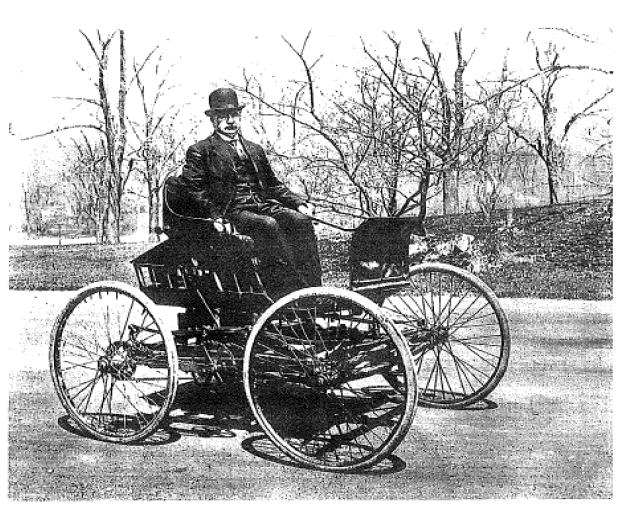 Elwood Haynes in his automobile, circa 1900.