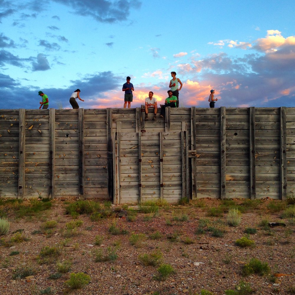 Epicenter staff, friends, and artist Lisa Ward enjoying the sunset from the top of The Bunker.