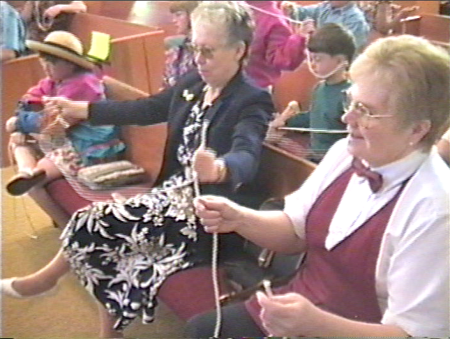 Green River residents participating in a Bill Adams magic performance at the Bible Church in 2003.