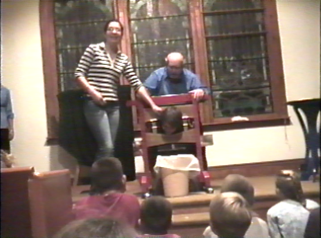 Bill Adams, a previous resident and river runner, performing a guillotine magic trick at the Bible Church in Green River circa 1995.