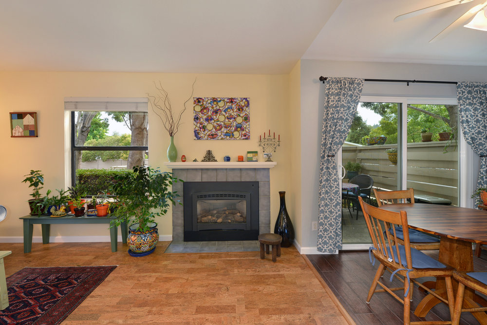 Lovely and updated, 2bd/2ba, corner unit condo, centrally located. The remodeled open floor plan kitchen has newer stainless appliances, new counters, subway tile backsplash, tiled floor, and new soft close cabinets. There are gorgeous cork floors throughout,  stunning bathroom remodels, walk-through closet in master bedroom, fresh interior paint throughout, private patio, a single car garage, pool, spa, clubhouse & fitness room. This is a beautiful home, turn-key ready! OPEN HOUSE August 5 & 6 from 1-4pm