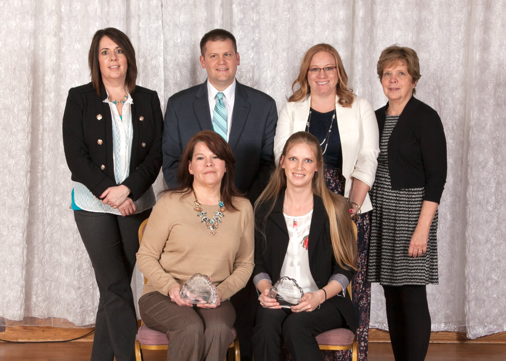 Back row: Chris Singer, Mike McConnell, Allison Crock (honoree), and Pat Galioto. Front row: Renee Steurer and Mandi Hostetler (both honorees)