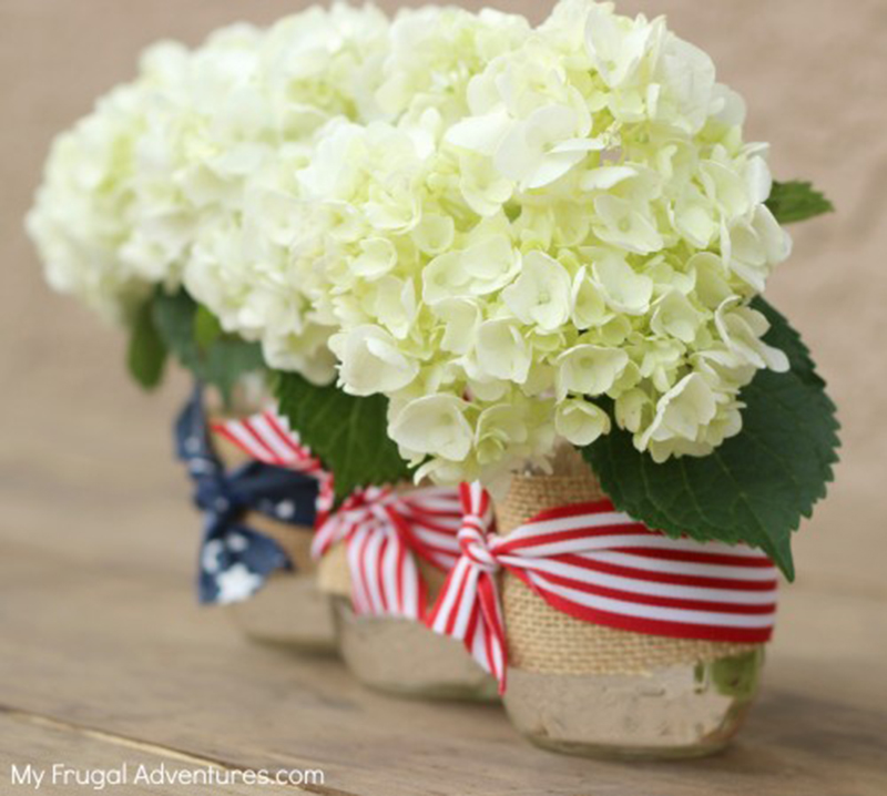 Photo Source: http://myfrugaladventures.com/2013/06/super-simple-4th-of-july-mason-jars/   July 4th patriotic ribbon available at Prairie Garden in Champaign, IL.
