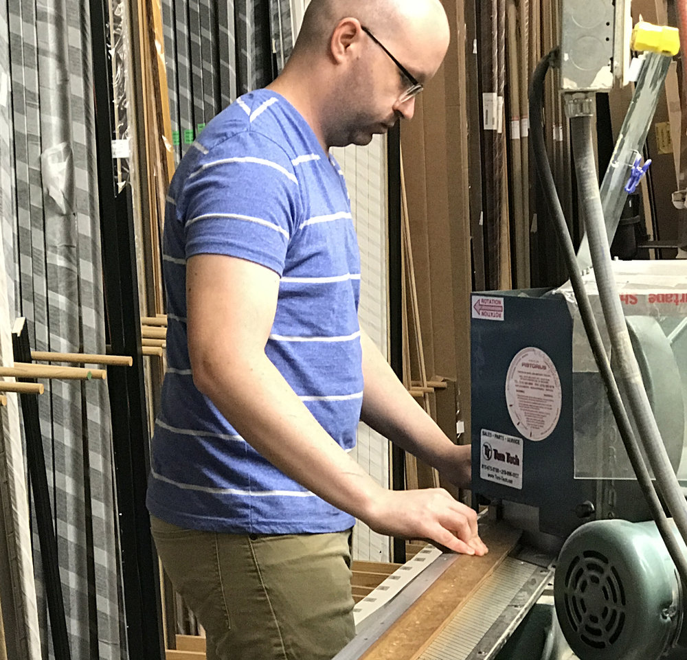 Travis cuts each and every wood molding and pieces the frame together.