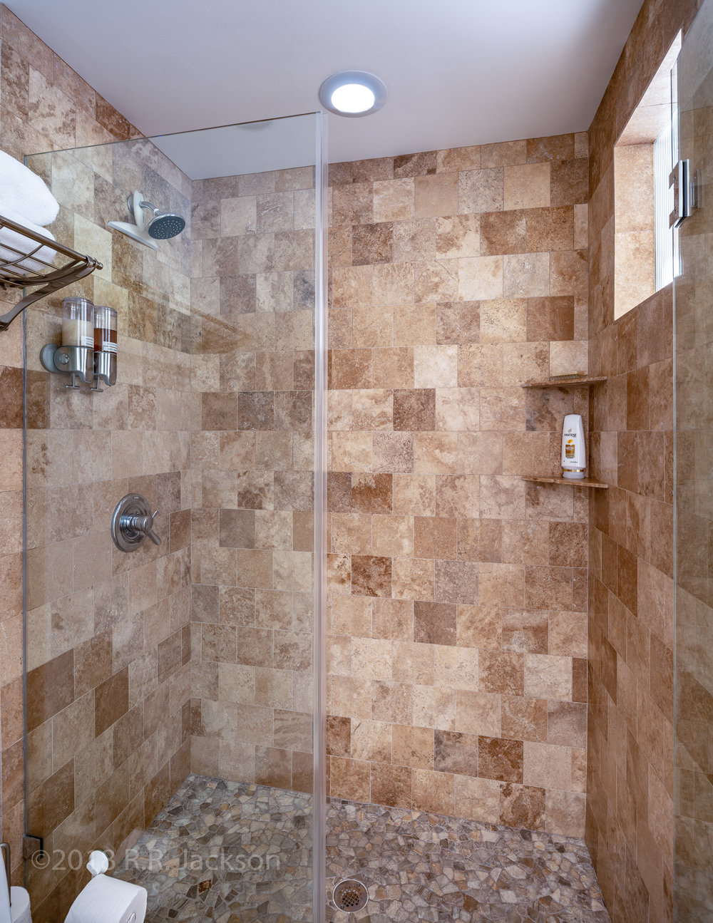 Walk-in shower with all that you need.