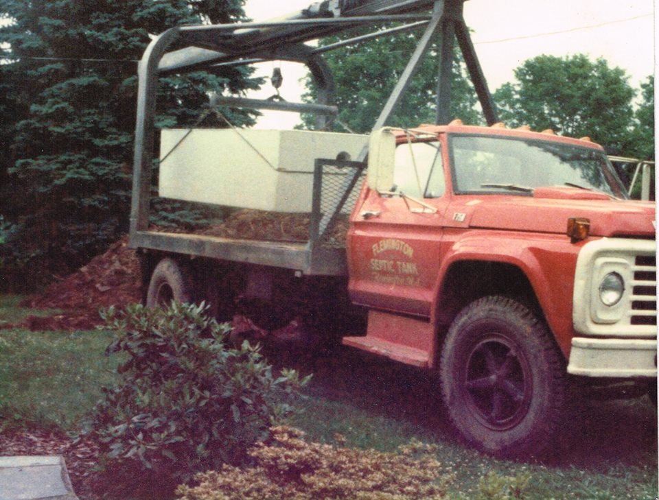 Previous owner George W. Hoffman delivering a septic tank, circa 1980's.