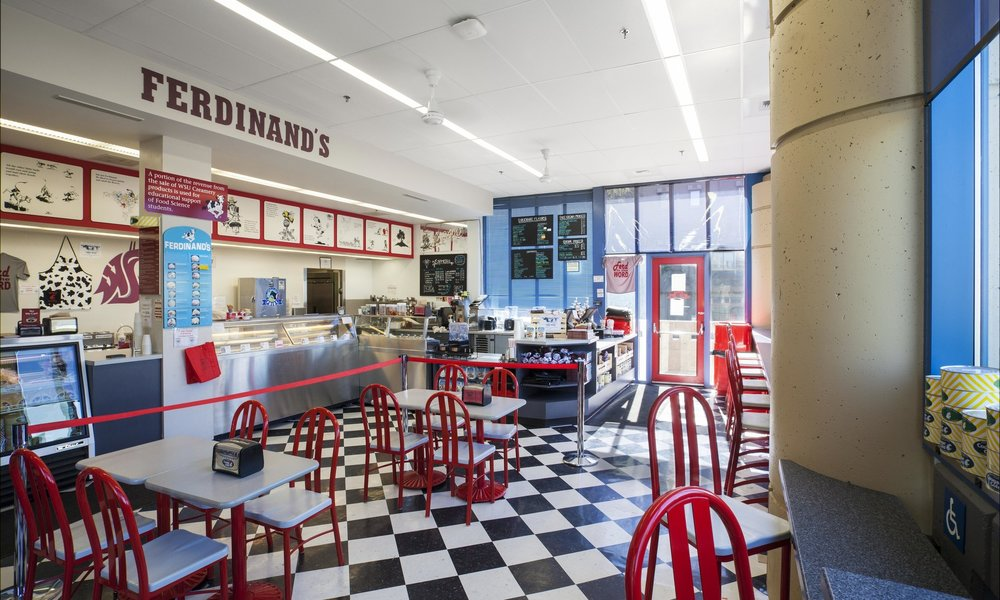 Owner: Washington State University Location: Pullman, WA   WSU Creamery provides teaching and research opportunities to students through the production of creamery products to be sold to students and members of the community. Ferdinand's, the creamery storefront, is designed with the atmosphere of an old-fashioned ice cream shop while still providing the durable commercial food prep and storage areas required.