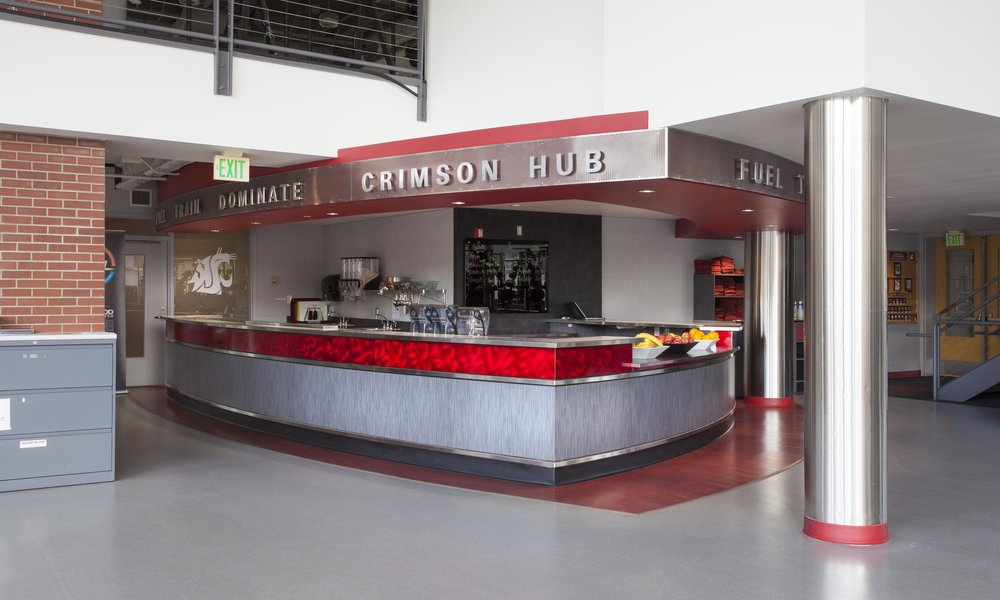 Owner: Washington State University Location: Pullman, WA   The Crimson HUB Snack Bar included custom casework, signage, and food equipment to provide healthy food options for students and athletes using the weight training room at the Bohler Gym addition. The project included a smoothie bar, self-serving equipment, and efficient work areas for staff behind the counter.
