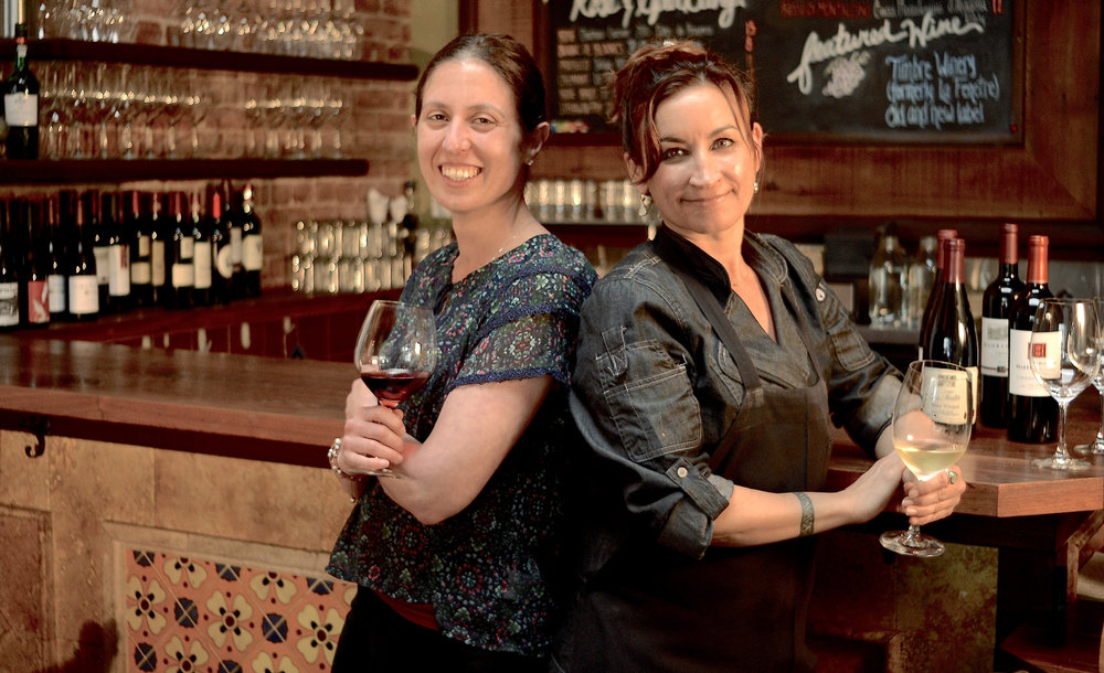 meet us. - Wine Curator Tina and Chef Kelly.Dedicated to providing the community locally sourced and nourishing goodness.