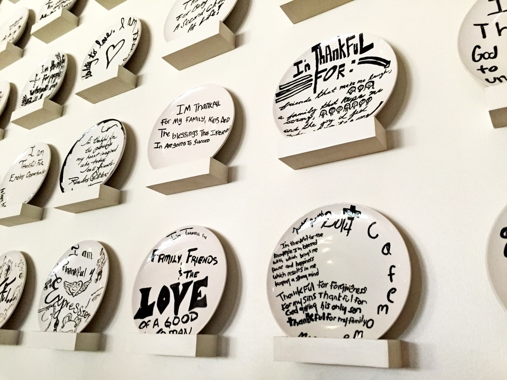 Painted plates scripted with inspirational quotes adorn the walls.