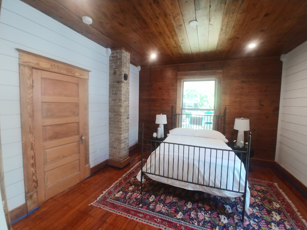 901 Spence Master Bedroom - All original walls, floor, doors, trim. Ceiling and wall with natural and paint finishes. Original chimney. Fully renovated master bath.