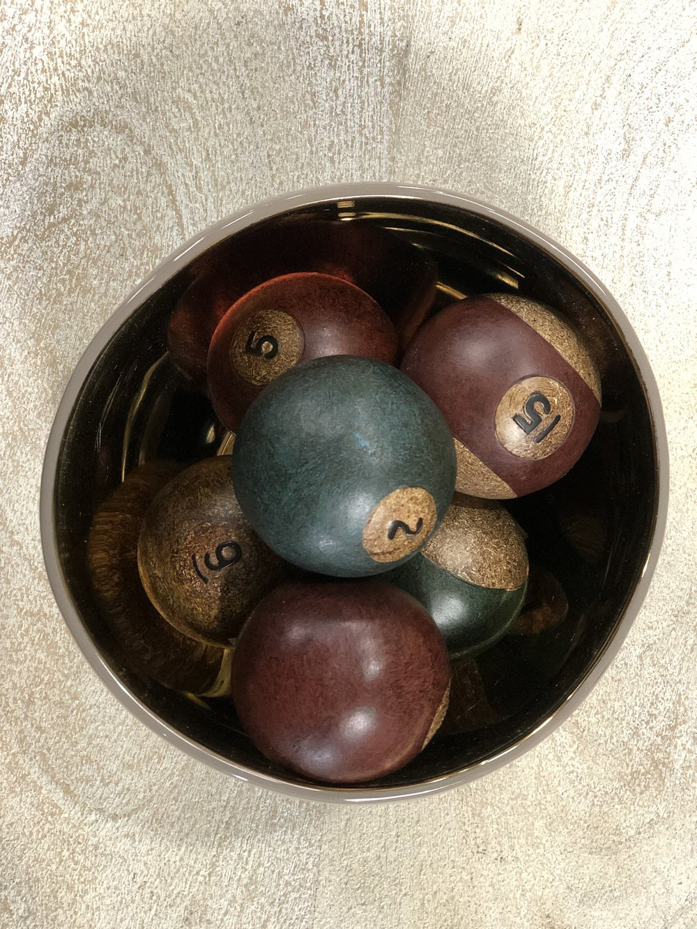Koballen Ornamental Balls - These wooden billiard balls will bring warmth when set on a shelf placed in a wooden bowl. Keep them on your coffee table in times of harmony, or just out of reach when your in-laws have overstayed their requisite 3 day stay.