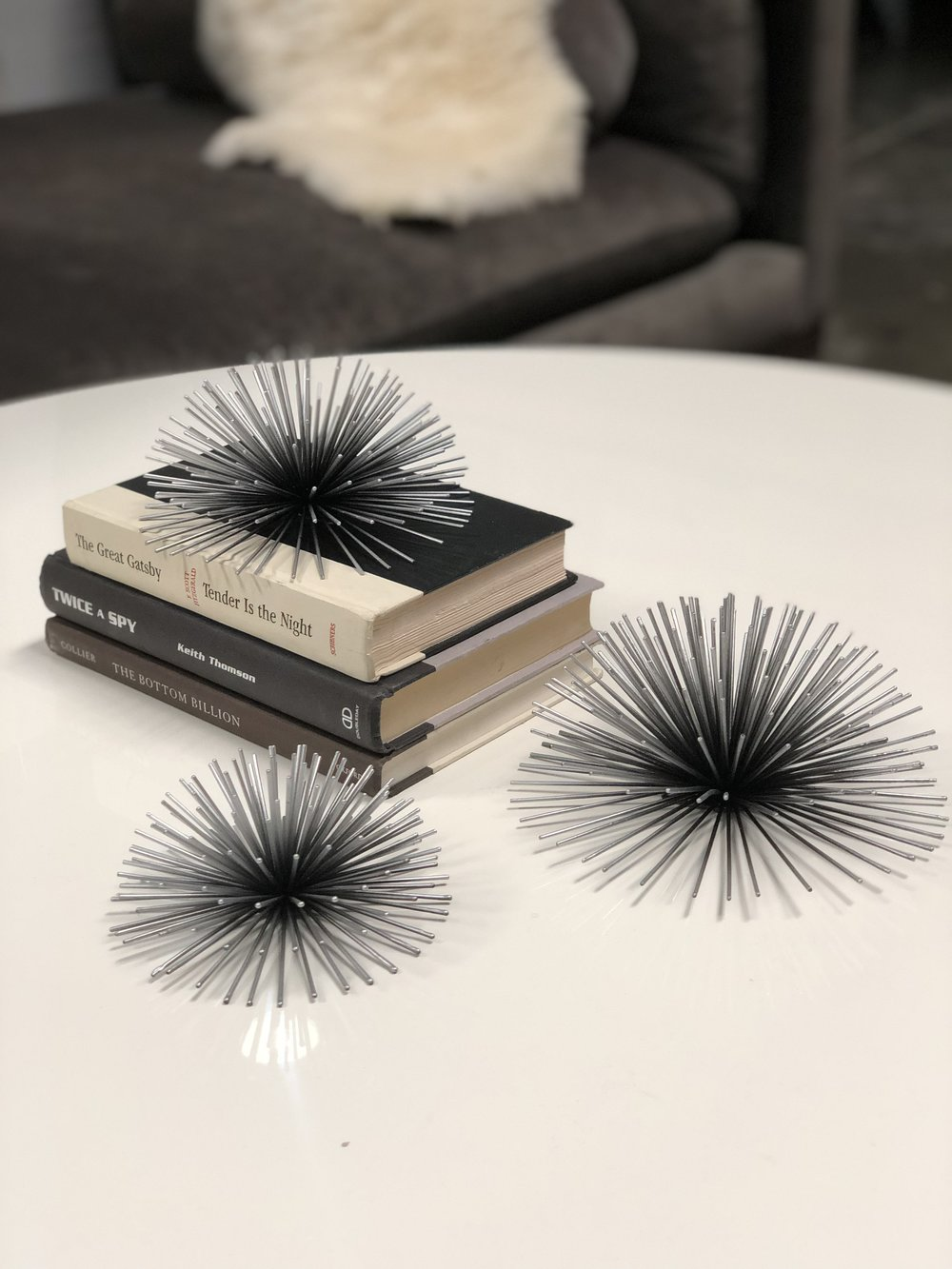 Stjerne Wall Art or Table Art - Bring shimmer to your wall, coffee table and bookshelves every day of the year with this metal starburst set. A little glam, a little wow, and a little painful if you accidentally mistake them for a massage roller...wait, maybe we're onto something!