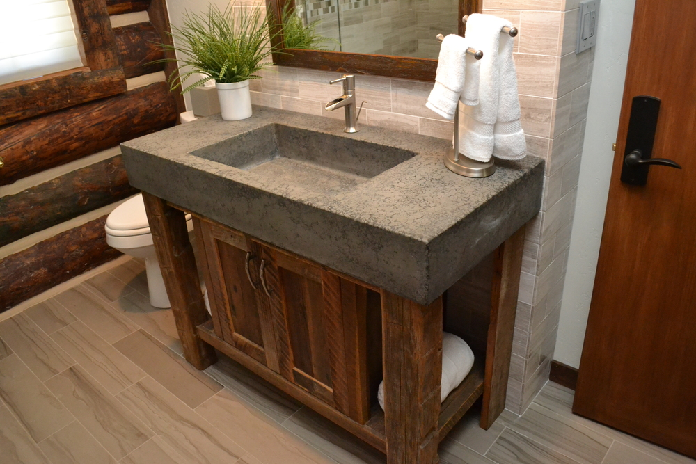 Custom concrete vessel sink in log home