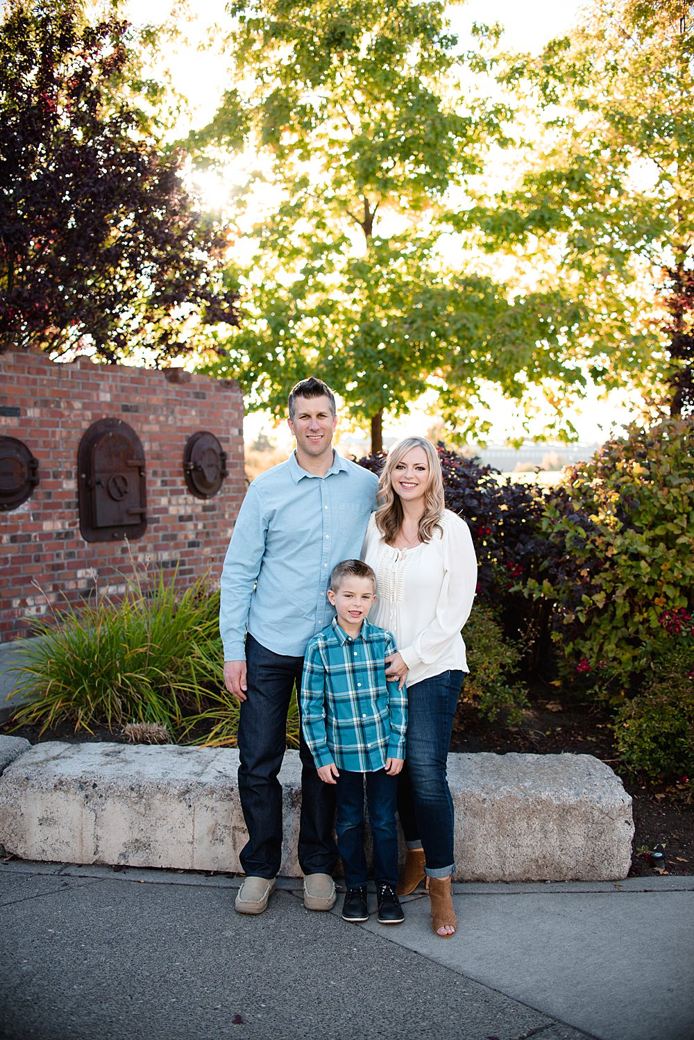 Family poses in the Old Mill District in Bend Oregon