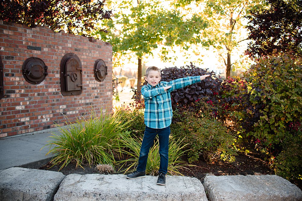 "A young boy does the ""dab"" in the Old Mill District in Bend, Oregon"