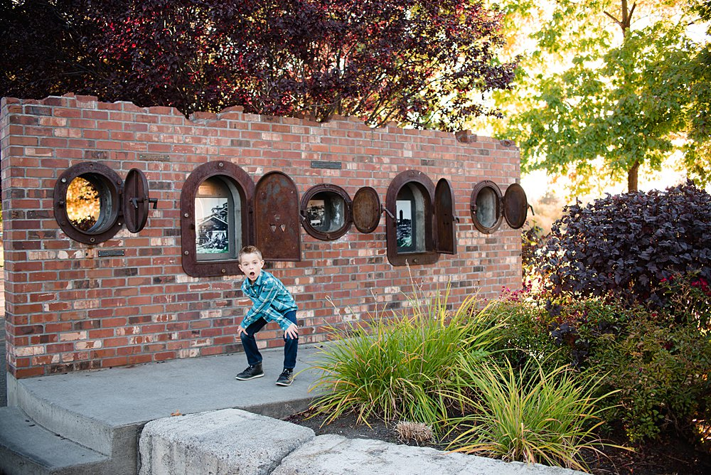 A boy plays around in the Old Mill District