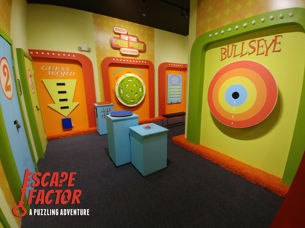 "CHOOSE FROM OUR TWO 60 MINUTE EXPERIENCES:  $32/person ($96 minimum)  - The Timekeeper's Trapped!  (4-10 guests)  - Bonus Fun Time Game Show Challenge  (2-8 guests) [pictured above]    K-8 POLICY:    All (1-hour) Saturday rooms containing children K-8 MUST be booked as a private room    (select ""book entire experience"").    For non-private (public) bookings on other days,  at least one paid adult must accompany the children."