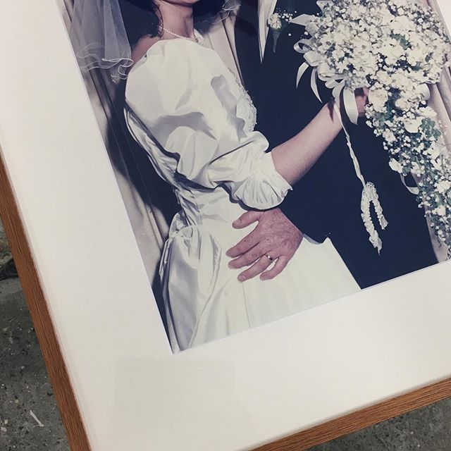 Me. I always wonder if I'll regret what I wore to my wedding.  Client. Trust me, you won't. They were called the tragic 80's for a reason 👰🤵 . . . #billabongframinggallery #pictureframing #customframing #interior #design #style #80sfashion #shoulderpadsfordays