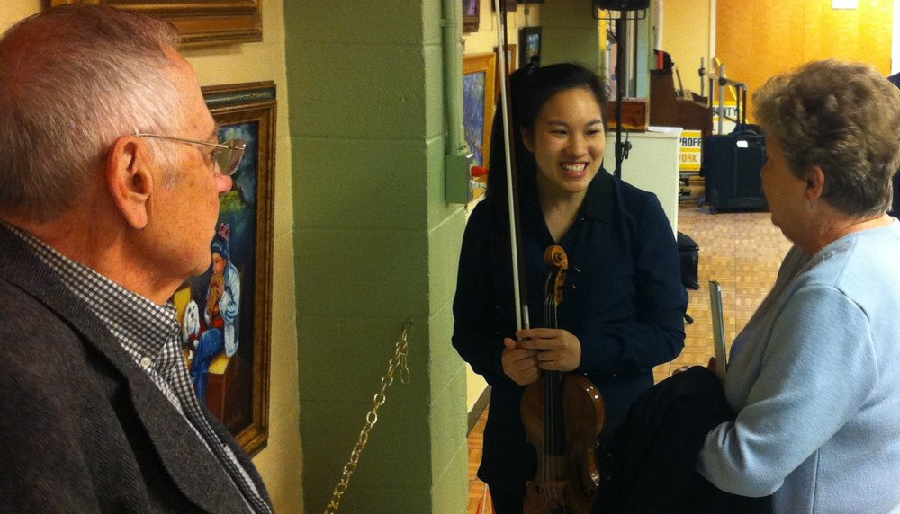 violinist Harmonnia Junus with fans at Hunterdon Senior Center.jpg