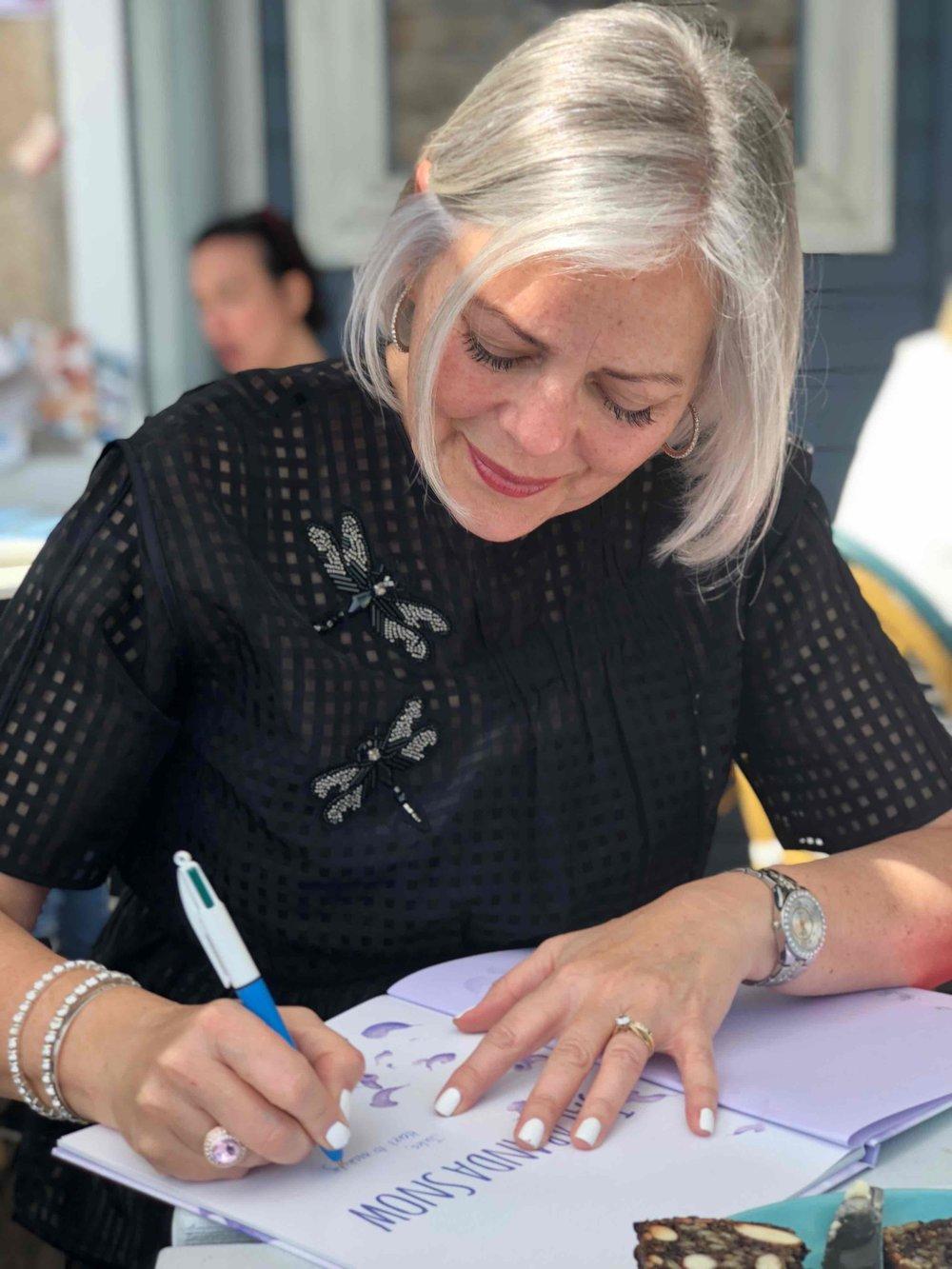 Catherine signing.jpg