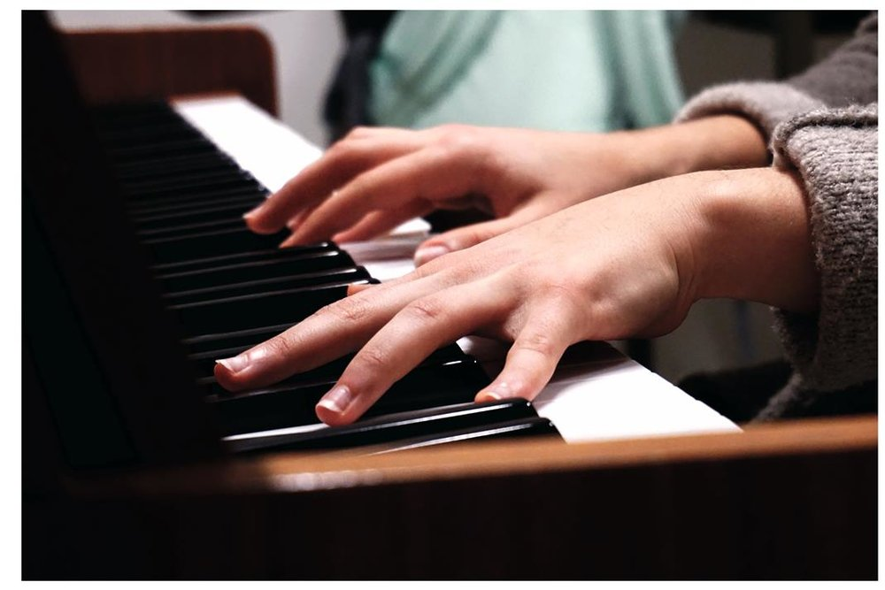 hands-playing-piano.jpeg