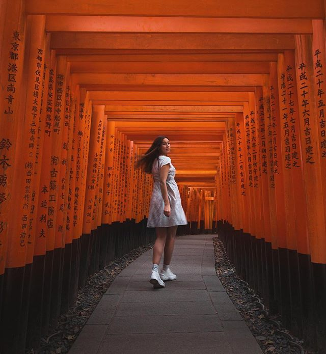 "I remember, only a few years ago, watching the little Maiko run up the hill through thousand of torii gates on TV. ""The Geisha"" is still one of my favorite movies, and it certainly sparked a big wave of tourists coming to visit the famous Fushimi Inari Shrine in Kyoto.⛩ In fact, it's so popular that you have to be here before 7 AM to really appreciate the serene beauty of this Shinto Shrine. No chance to snap a good photo any later than that! I'm sorry night owls, but the early bird catches the worm. And that's true for all of Kyoto.  If you feel up for a challenge you can even hike all the way up to the summit of the hill - it takes usually 2-3 hours. . . . #visitjapan #fushimiinari #kyoto #kyotojapan #japantravel #travelcommunity #wearetravelgirls #sheisnotlost #femmetravel #backpackerstory #passionpassport #traveladdict #theglobewanderer #girlsthatwander #dametraveler #darlingescapes #globelletravels"