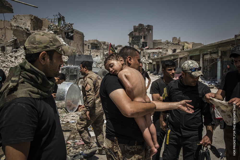 The Battle for Mosul - Young Boy Is Cared for by Iraqi Special Forces Soldiers