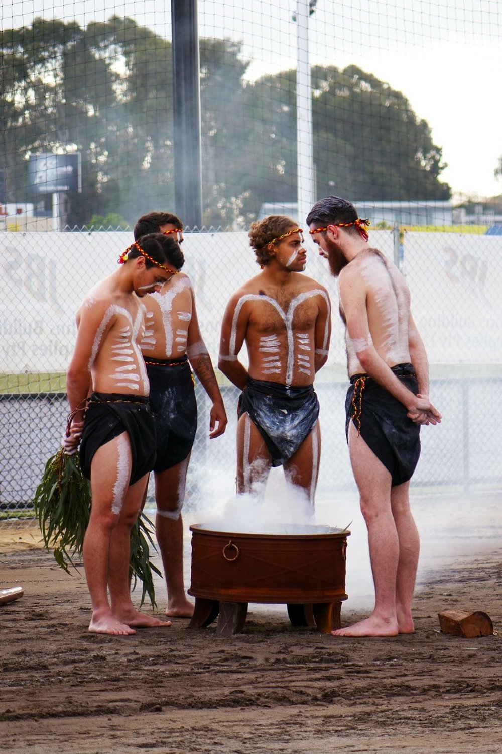 Baldja Moort performing a smoking ceremony and dancing for the west coast eagles.