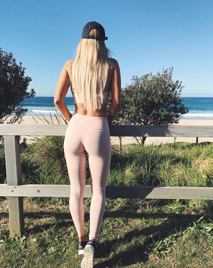 @yasmin_renshaw Yasmin wears the Nude High Waist Leggings and Strap Bra on a beach-side hike.