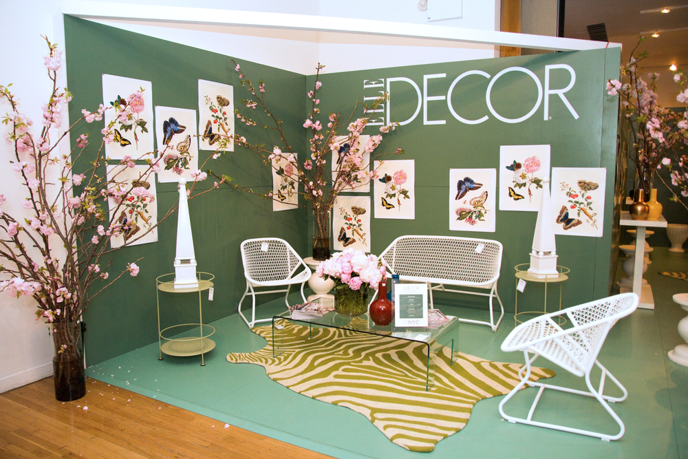 ELLE DECOR garden vignette furnished by Global Views, Fermob, CalLigaris, and Loloi