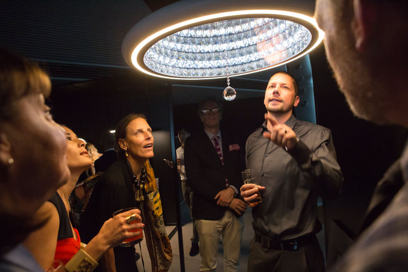 Guests learning about Swarovski Lighting's Infinite Aura collection