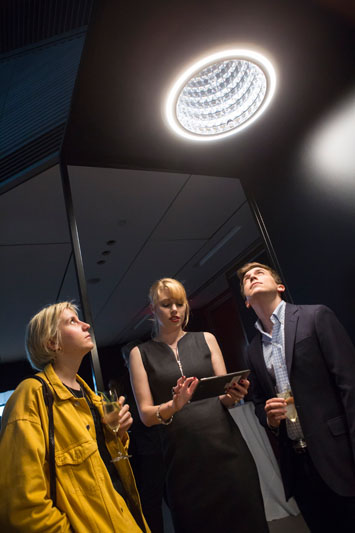 Petra Oberhauser demonstrating how guests can control Swarovski Lighting's Infinite Aura collection through the app