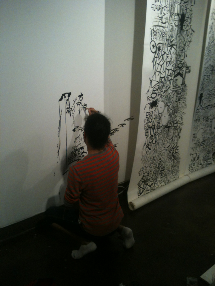 Art Practice second year exhibition installation in progress: participant Renyi Hu works on his piece at the Visual Arts Gallery.