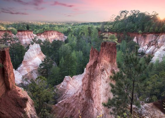"Known as the ""Mini Grand Canyon"". While it's huge in size, it's not easily found on a map and most locals don't even know it exists. Hike, backpack, stay the night, and enjoy the beautiful hues of pink, purple and orange."