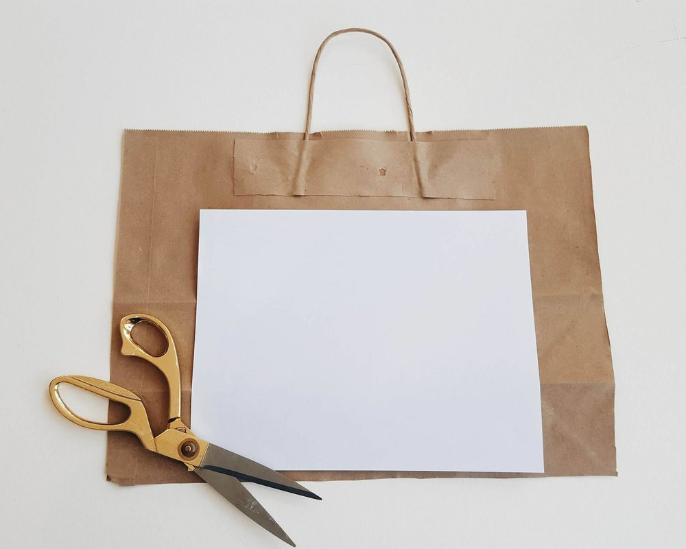 Create the outside cover of your journal by cutting a piece of kraft bag to the size of your standard office paper.   After cut to correct size, I quickly and imperfectly trimmed the outsides of the office paper to create a jagged-uneven texture.