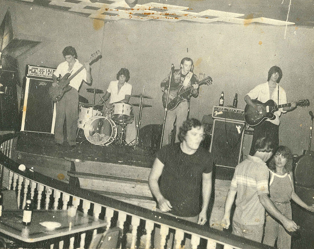 A young Stevie Vaughan onstage at the Rome Inn w/ Eddie Stout, David Murray and Steve Fulton. (photo by Kathy Murray)