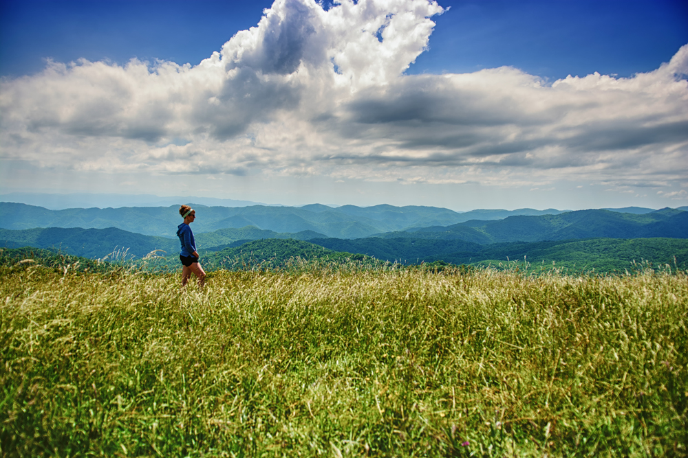 "6/19 Photo: On top of Max Patch with a dear friend! Tennessee is known for its tall mountains called ""balds."" They are basically devoid of trees but open grassland at 6,000 feet. They only occur in certain places (TN being the main one)."